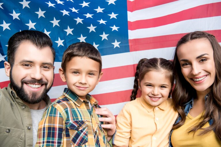 happy family with children holding american flag