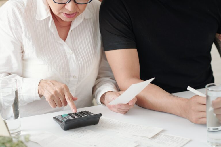 Son helping mom with expenses