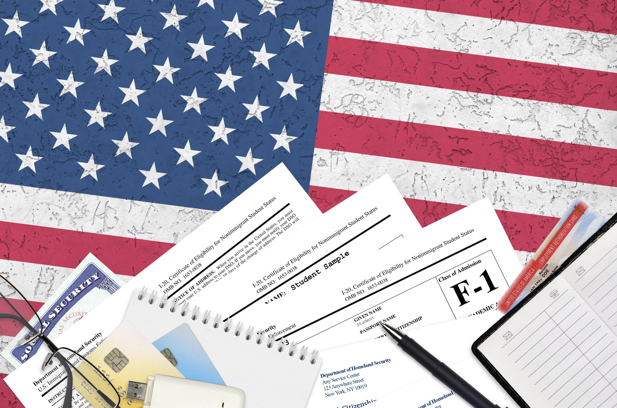 USCIS form I-20 Certificate of eligibility for nonimmigrant student status lies on flat lay office