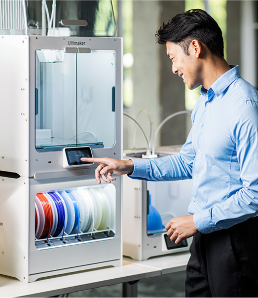 Man standing in front of 3D printer