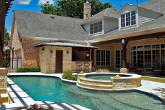 Outdoor-Kitchen-with-outdoor-bathroom-Arbor-seating-area-in-The-Woodlands-Texas.-JM-Outdoor-Living