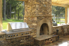outdoor-fireplace-with-small-outdoor-kitchen-in-The-Woodlands-Texas.-JM-Outdoor-Living