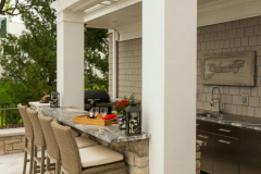 Outdoor-kitchen-bar-with-attcheed-pergola-in-The-Woodlands-Texas.-JM-Outdoor-Living