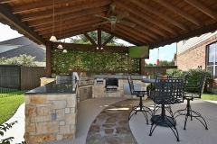 Summer-kitchen-with-grrill-and-3-burners-open-beam-gable-roof-in-The-Woodlands-Texas.-JM-Outdoor-Living