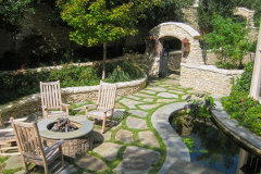 Accent-walls-and-outdoor-firepit-and-water-fountain-in-The-Woodlands-Texas.-JM-Outdoor-Living