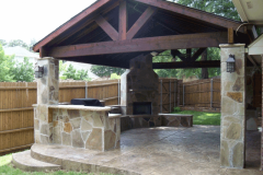 Exposed-beam-patio-cover-with-outdoor-kitchen-and-Outdoor-Fire-place-in-The-woodlands-Texas.-JM-Outdoor-Living