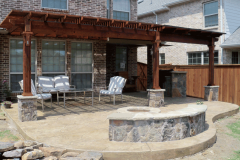 Pergola-with-outdoor-kitchen-Fire-pit-and-seting-bench-in-The-Woodlands-Texas