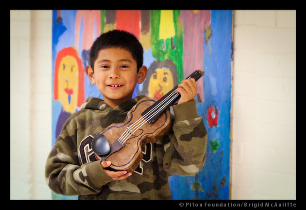 Student with newly made Papier-mâché violin