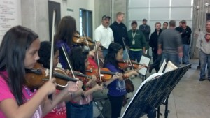 Garden Place students perform at a nearby Century Link facility as part of a United Way promotion.