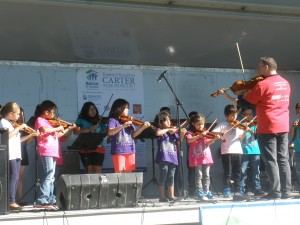 Students perform at the recent Kick-Off event for Habitat for Humanity's Carter Work Project. Habitat is building over a dozen affordable housing units in the Globeville neighborhood.
