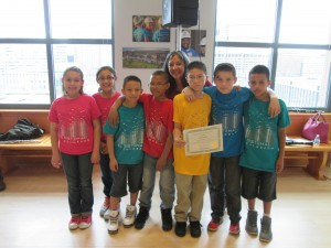 Woodwinds students from Garden Place receive a certificate of recognition from Councilwoman Montero at the opening of a new exhibit on Globeville.