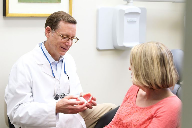 Dr. Layton explaining root canal therapy to patient