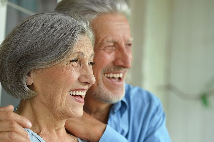 Couple smiling showing off teeth