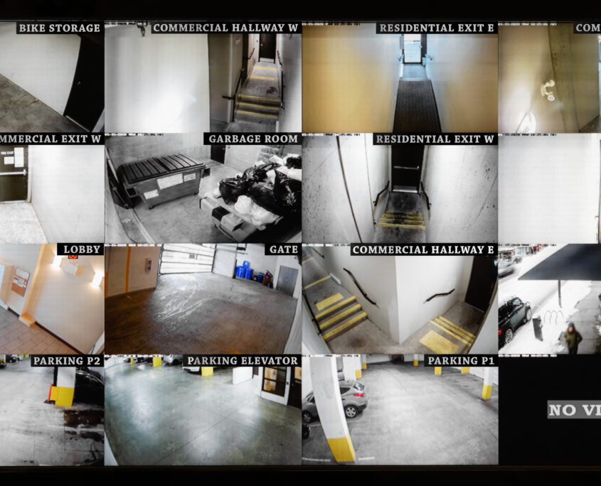 Security camera monitoring screen. 16 camera slots. Small high end system of residential, commercial or strata building. Parking, gate, garbage and recycling room, staircase and hallway