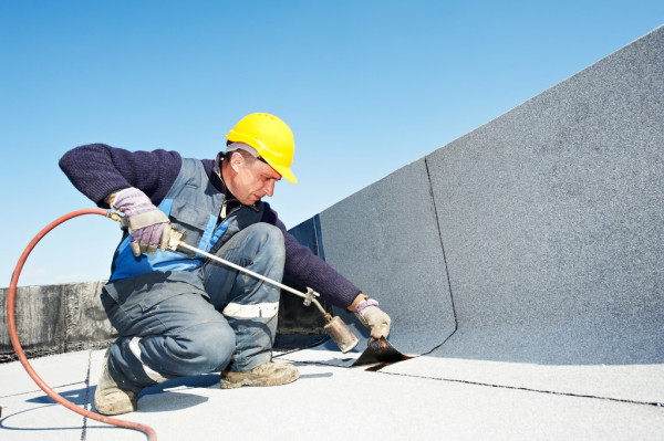 depositphotos 10460068 stock photo flat roof covering works with