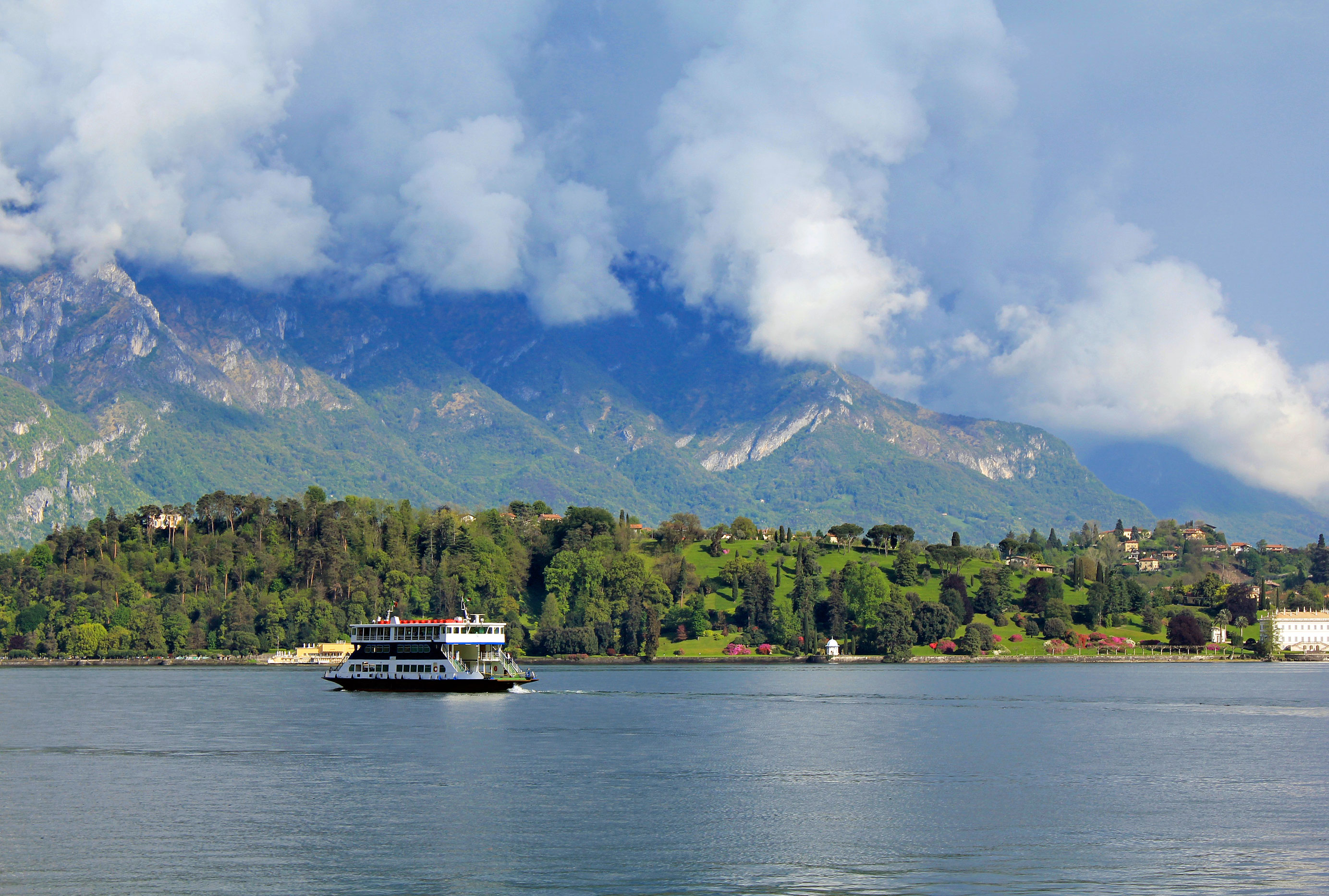 A Boat Transports Tourists on Lake Como