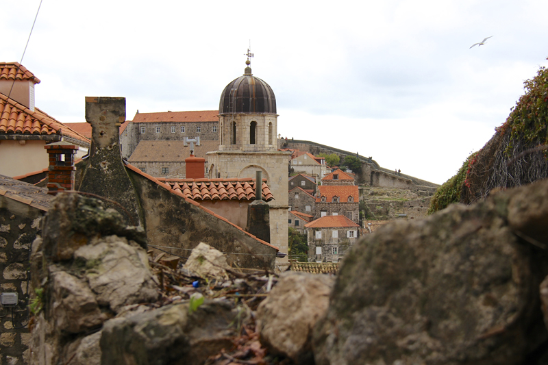 Dubrovnik is a fortified city with charming tile roofs peeking out just below the peak of the walls
