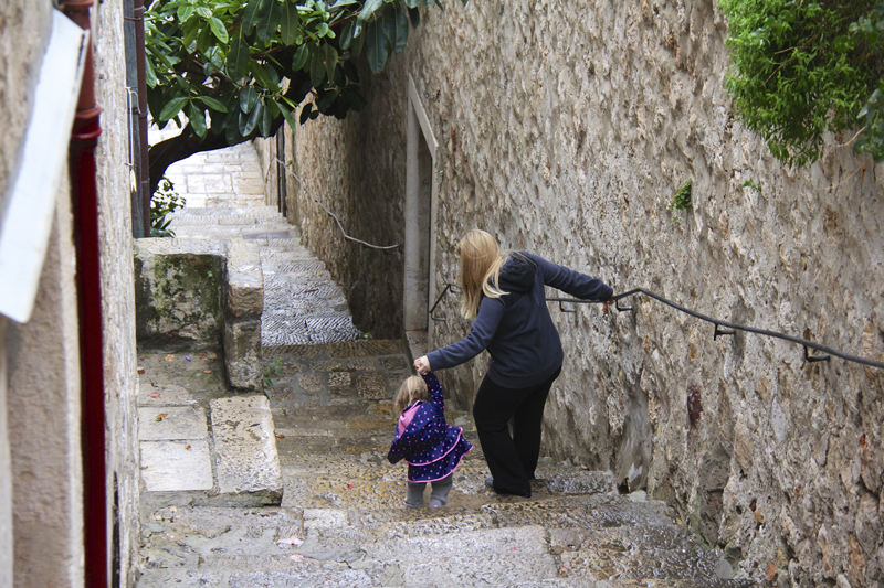 Jen guides Julia down a long stairway...