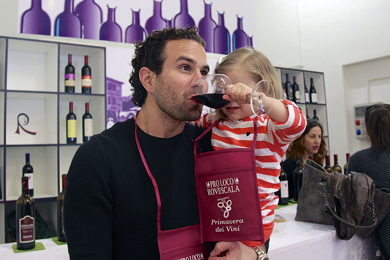 Julia carefully helps me select my favorite wine