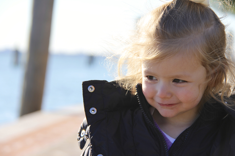 Julia walks on the pier of Burano