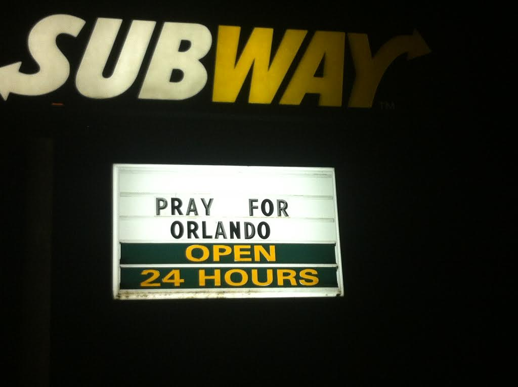 """ORLANDO, FL JUNE 12, 2016 - The Subway store near Pulse night club provided parking for some of the countless news trucks and added the words """"PRAY FOR ORLANDO"""" to their sign.  Image credit: 1776 Channel"""