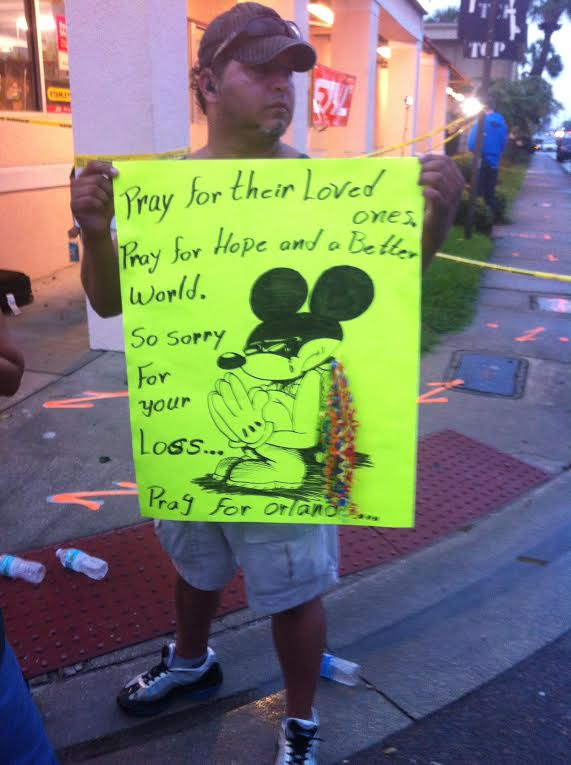 """ORLANDO, FL - JUNE 12, 2016 A sign reads """"Pray for Orlando"""" and depicts a crying Disney Mickey Mouse.  Image credit: 1776 Channel"""