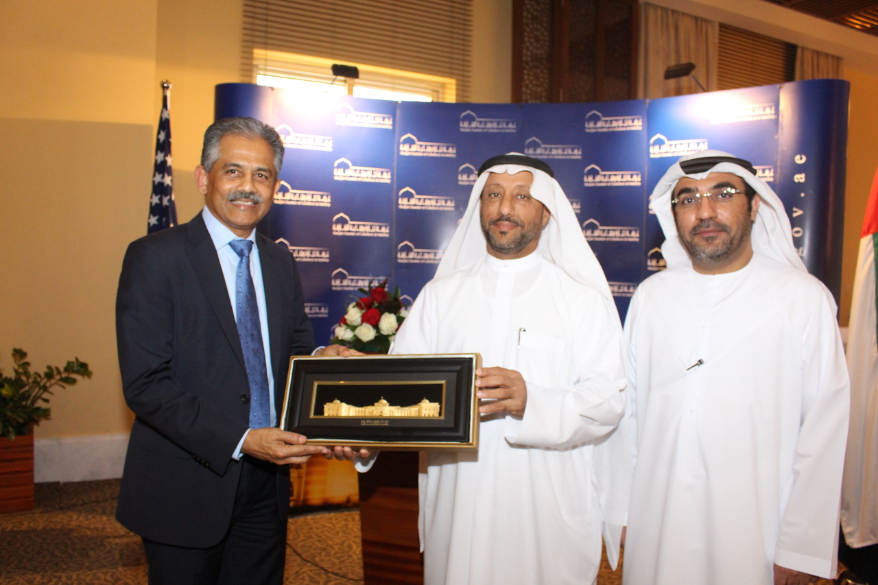 SHARJAH, UAE - FEBRUARY 19, 2015 - SelectUSA Director Ambassador Vinai Vinay Thummalappally appears to be receiving a gift during a luncheon in his honor sponsored by the Sharjah Chabmer of Commerce and Industry. Crescent and Gulftainer are headquartered in Sharjah.