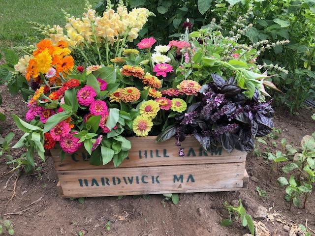 crate of flower arrangements