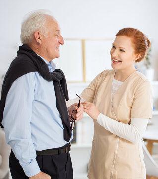 caregiver helping her senior patient