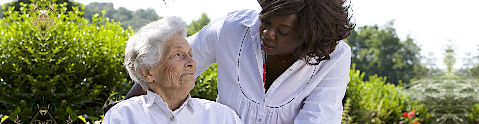 senior woman on a wheelchair and her caregiver