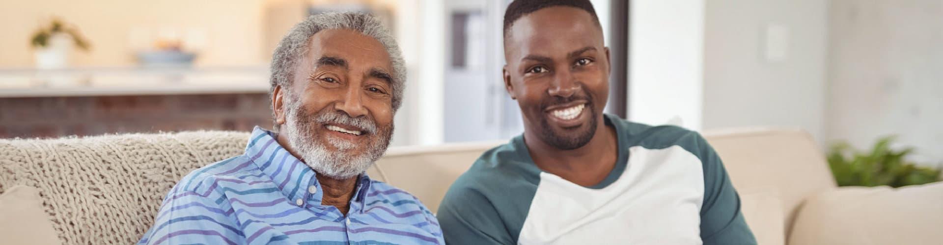 senior man and man smiling
