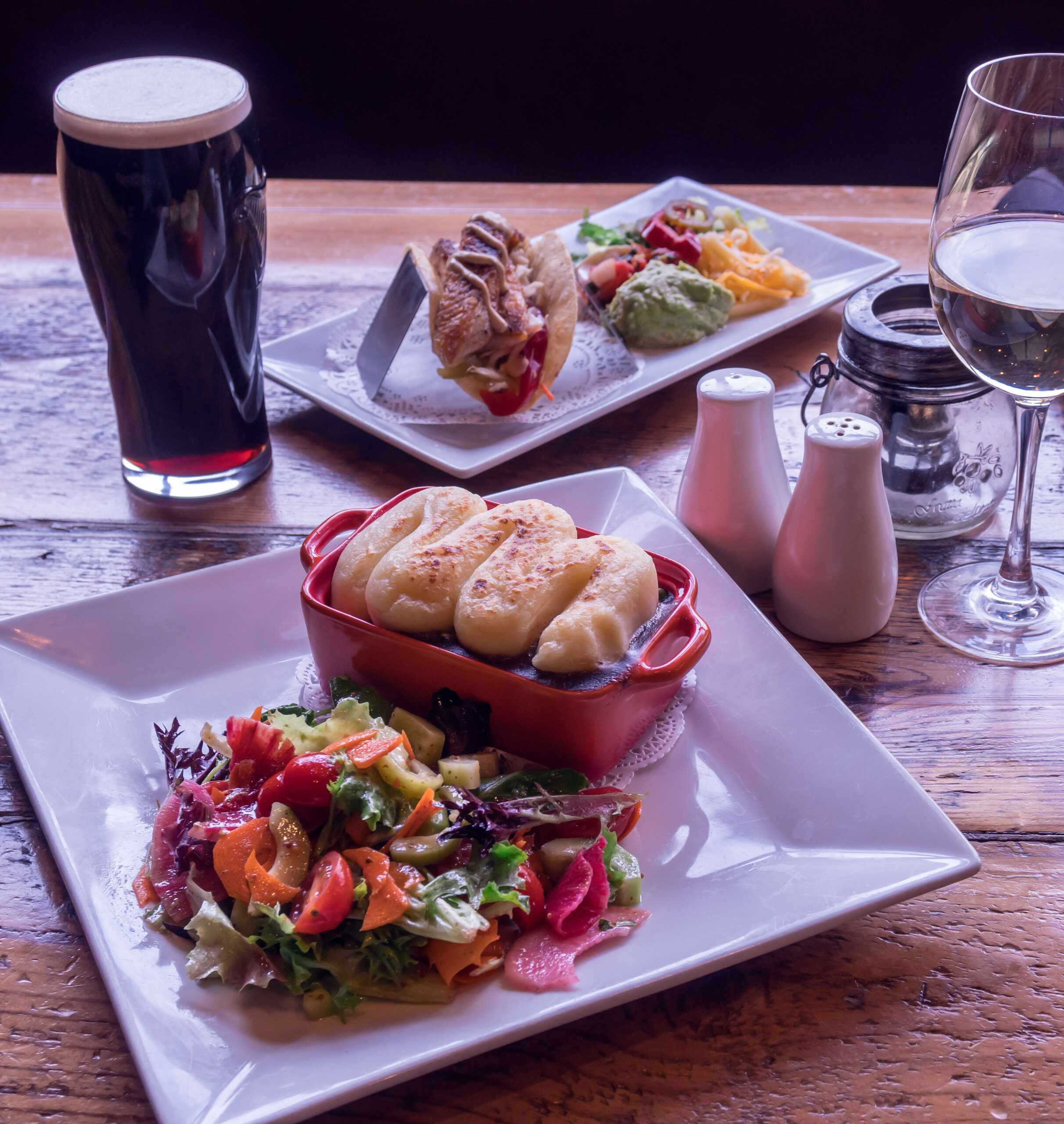 house shepherds pie with fresh green salad. fish taco with fixings. white wine and guinness