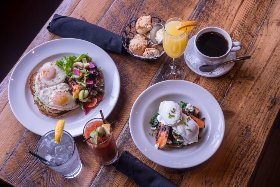 brunch breakfast for two from above, two signature egg plates, homemade scones, chilled mimosa and bloody mary, with hot coffee and ice water