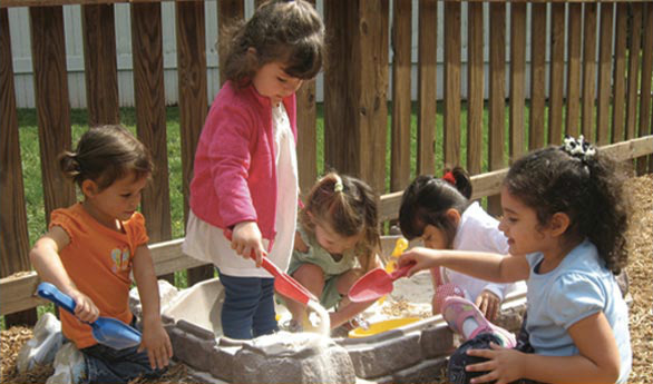 Preschool children playing in sandbox