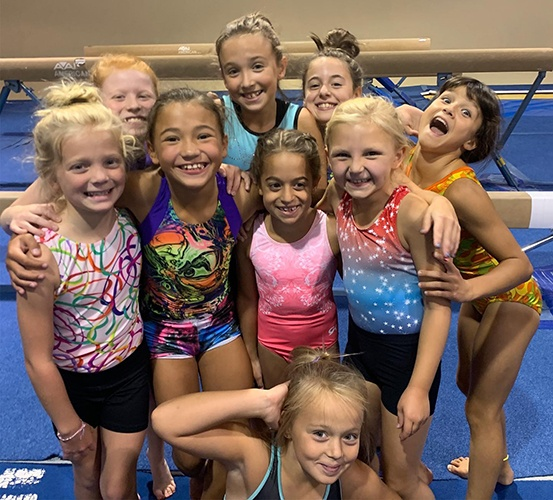 Gymnasts smiling in big group