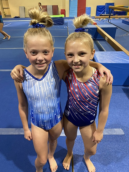 Two gymnasts smiling