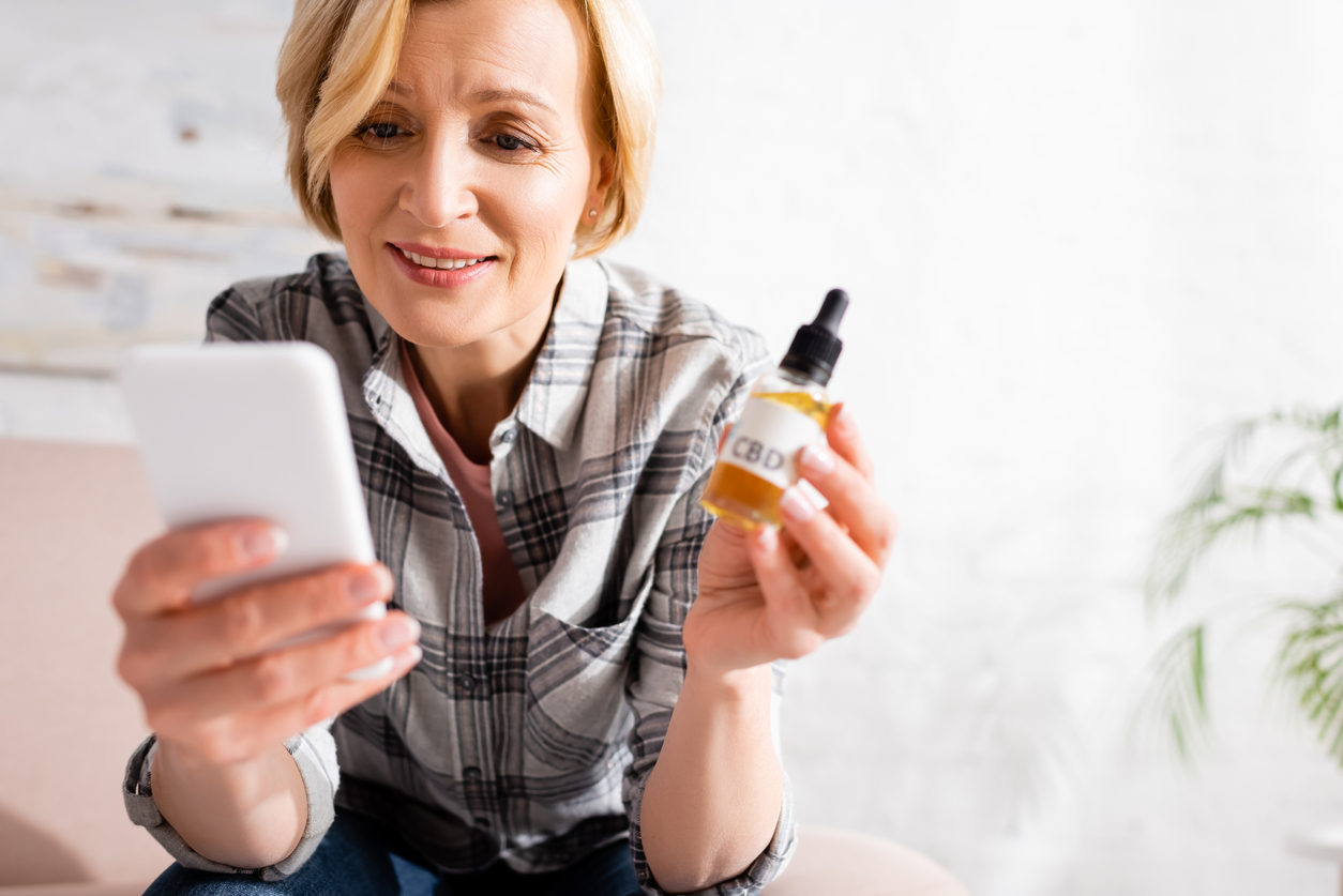 woman with CBD to treat back pain