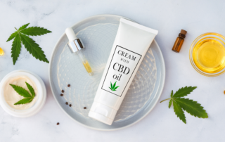 CBD oil lotion and tincture on white tray