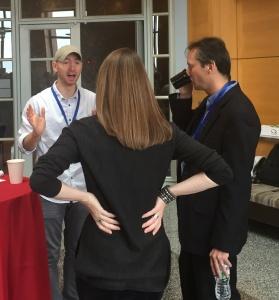 Lucas Blair talking with Zsolt Olah and Sari Gilbert.