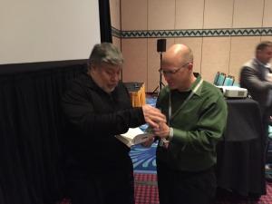 Steve Wozniak and Karl Kapp discuss games and gamification and Woz signs iWoz for Karl.