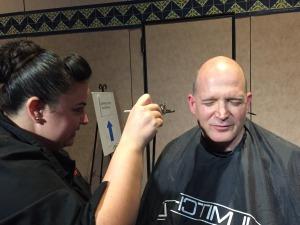 Disney make-up artist preparing Karl Kapp for his keynote with Elliot Masie.