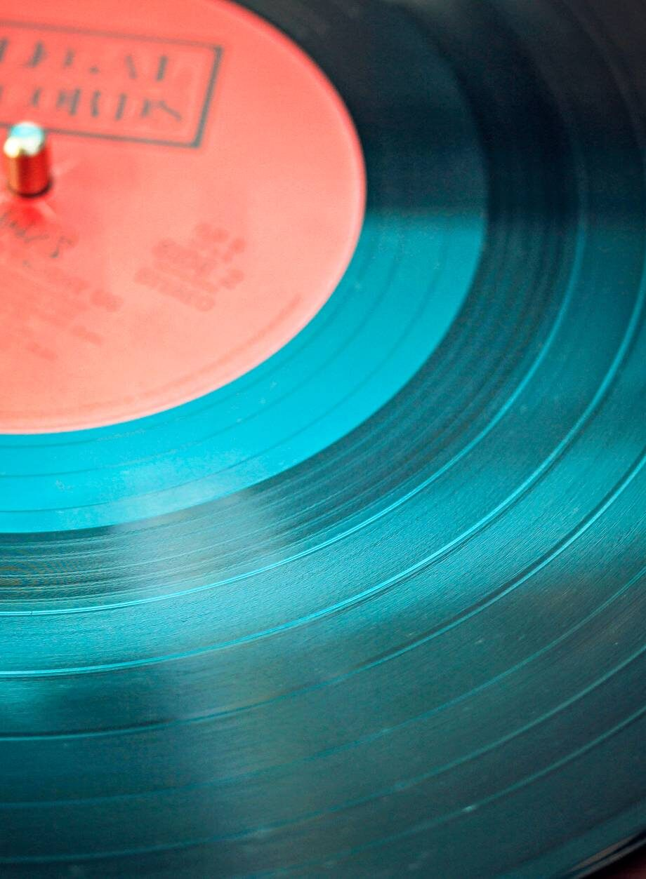 black vinyl record playing on turntable