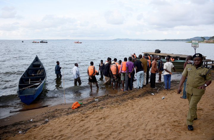 Rescue and recovery missions gather at the shores of Lake Victoria during the search for the bodies of dead passengers after