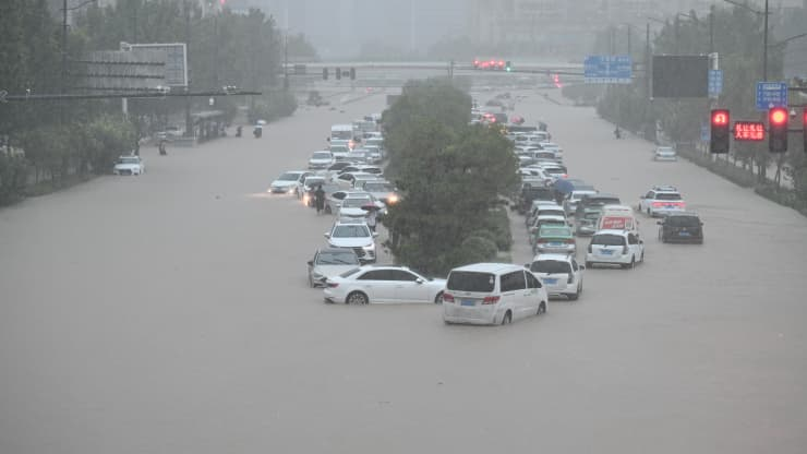 Vehicles are stranded in floodwater near Zhengzhou Railway Station, China