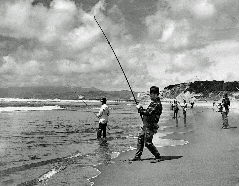 Men surf fishing at Ocean Beach in San Francisco. The Cliff House is visible in the background  San Francisco, California:  c. 1940(Photo by Underwood Archives/Getty Images)