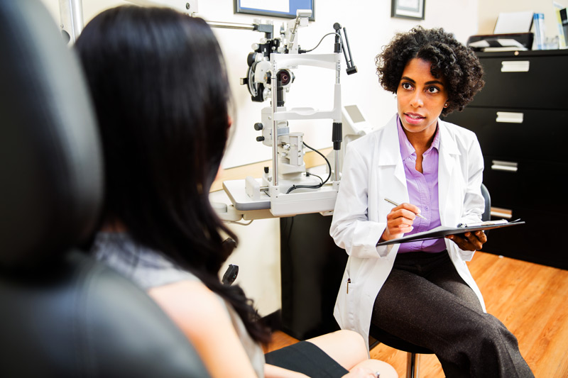 A doctor consulting a patient regarding their cataract eye surgery prep using the Bruder Sx pre-surgical patient prep kit