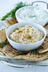 HUMMUS AND TZATZIKI WITH GRILLED PITA