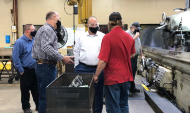 Scott Hoffman discusses a recent process improvement with employees of the Fisher Barton Zenith Cutter Division