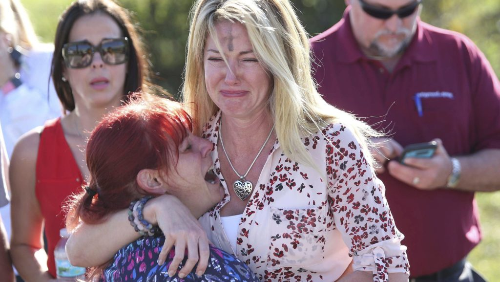 Undying sorrow.(AP Photo/Joel Auerbach)