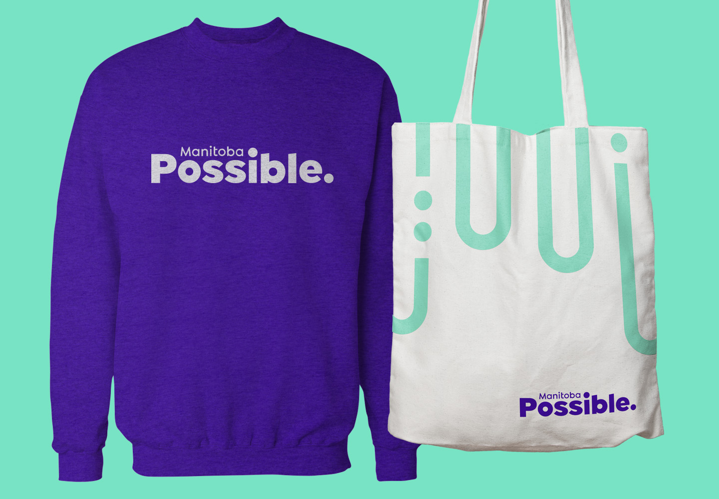 Manitoba Possible purple sweatshirt example and tote bag with the Manitoba Possible motif.